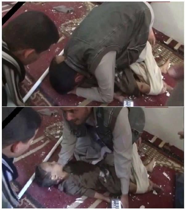 يمني يحضن حثة طفله، واحد من ضحايا تفجيرات إرهابية (انتحارية) يوم الجمعة 20مارس/ آذار 2015 استهدفت المصلين في مسجدين بالعاصمة اليمنية صنعاء وخلفت أكثر من 145 شهيدا ومئات الجرحى.