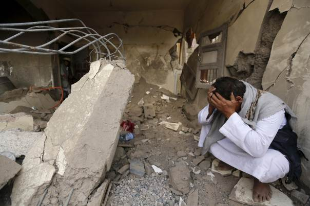 A man who lost his relatives in a Saudi-led air strike cries at the site of the air strike in Yemen's capital Sanaa